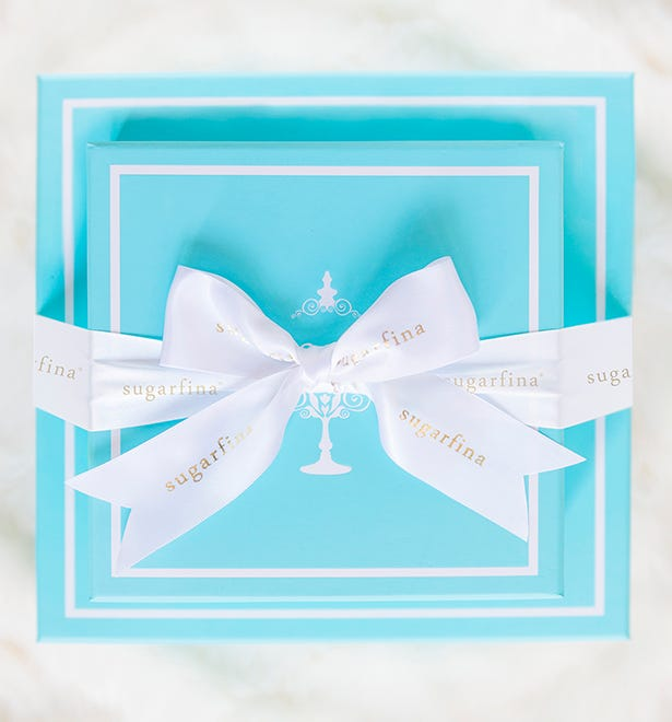 Put a bow on your gift! Top off your gift with a Sugarfina bow as the perfect finishing touch. Photo of Sugarfina Bento Box Gift with white and gold bow.